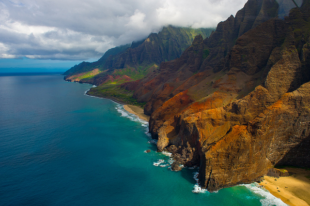 This fifteen-mile stretch of coastline is located on the northwest shore of Kauai. Much of Na Pali Coast is inaccessible due to its characteristic sheer cliffs that drop straight down into the ocean. This shot taken from a helicopter.