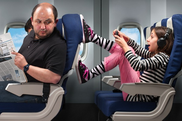 children-kicking-back-of-seat