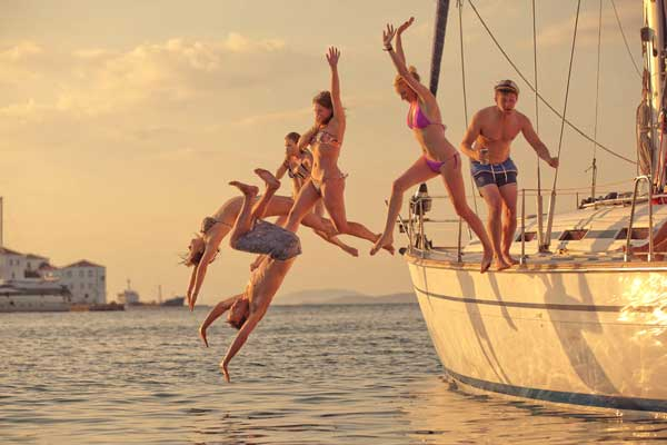medsailors-sailing-holidays-sunset-swimming-jump